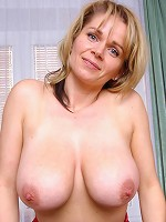 Busty blonde mature Timea showing off her juicy huge hooters