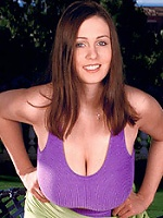 Busty British brunet with big natural slugs in a tight pink top.